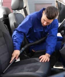 Man cleaning car seat.